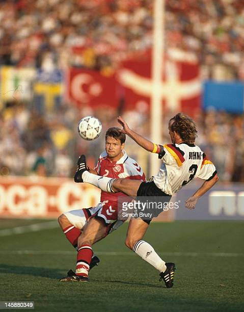 John Sivebaek of Denmark is challenged by Andreas Brehme of Germany during the UEFA European Championships 1992 Final between Denmark and Germany...
