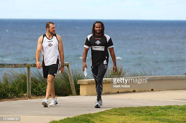 John Skandalis and Lote Tuqiri returns from a run during a Wests Tigers NRL recovery session at Coogee Beach on August 22 2011 in Sydney Australia