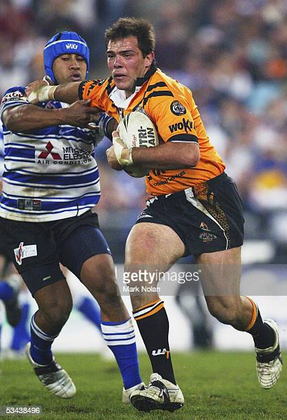 John Skandalis of the Tigers in action during the round 24 NRL match between Wests Tigers and the Bulldogs at Telstra Stadium on August 19 2005 in...