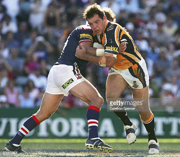 John Skandalis of the Tigers is tackled during the round four NRL match between the Sydney Roosters and the Wests Tigers at Aussie Stadium April 3...