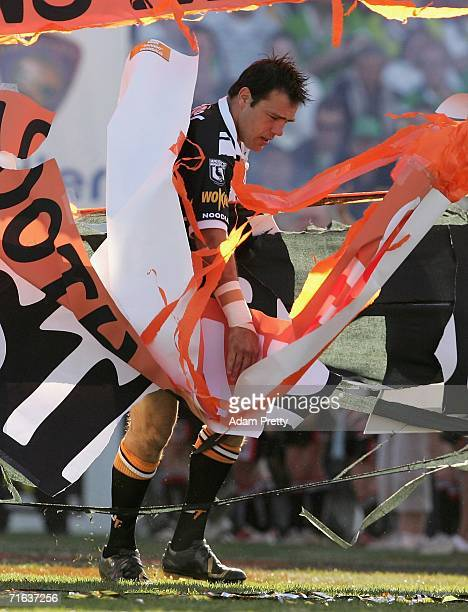 John Skandalis of the Wests Tigers runs onto the field for the last time during the round 23 NRL match between the Wests Tigers and the Canberra...