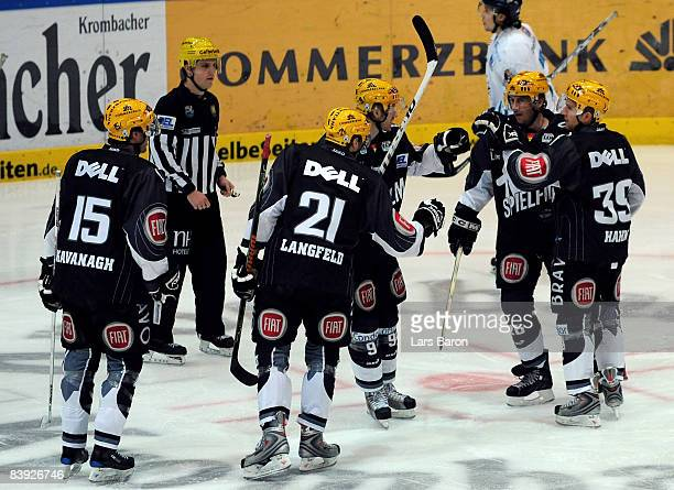 John Slaney of Frankfurt celebrates scoring the first goal with team mates during the DEL match between Frankfurt Lions and Straubing Tigers at the...