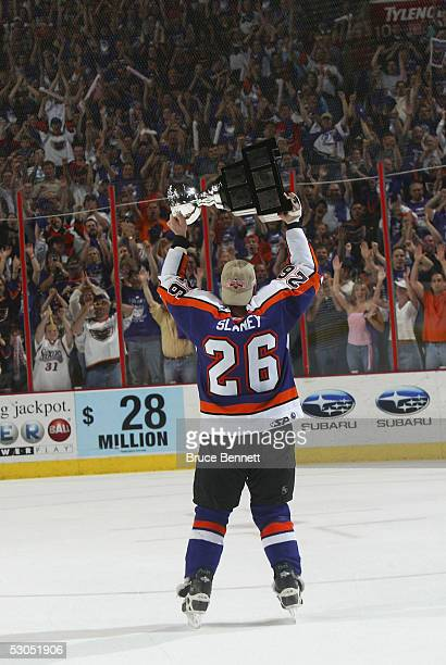 John Slaney of the Philadelphia Phantoms celebrates the Phantoms 52 Calder Cup win over the Chicago Wolves at the Wachovia Center on June 10 2005 in...