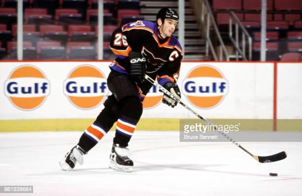 John Slaney of the Philadelphia Phantoms skates with the puck during an AHL game circa September 2002 at the Wells Fargo Center in Philadelphia...