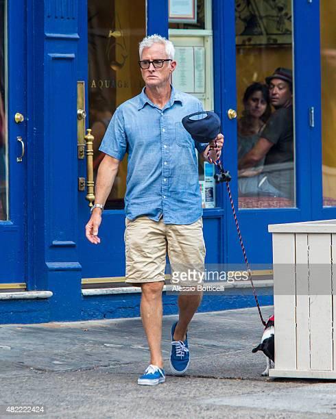 John Slattery is seen walking his dog in SoHo on July 28 2015 in New York City