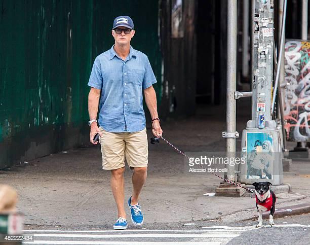 John Slattery is seen walking his dog in SoHo on July 28, 2015 in New York City.