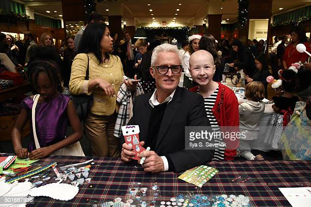 John Slattery poses with St Jude's patient child Kenlie at Brooks Brothers holiday celebration with St Jude Children's Research Hospital Brooks...