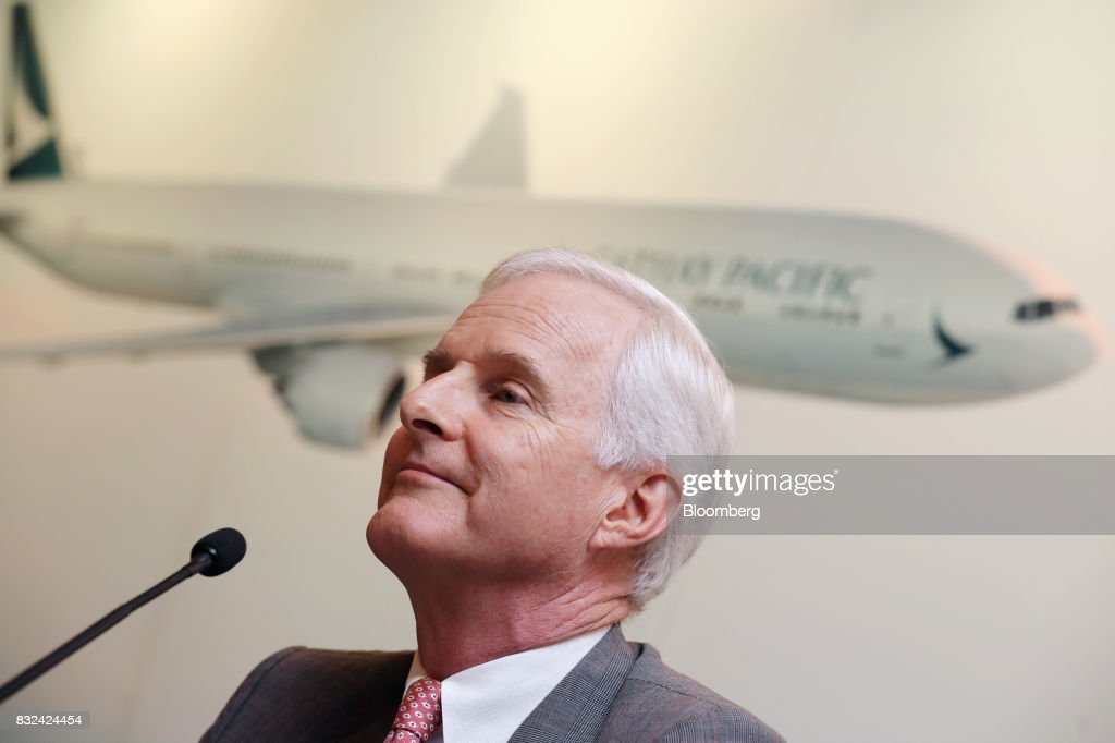 John Slosar, chairman of Cathay Pacific Airways Ltd., listens during a news conference in Hong Kong, China, on Wednesday, Aug. 16, 2017. Cathay Pacific is slipping in its efforts to get passengers to pay more for its premium services in a test for new Chief Executive OfficerRupert Hoggas the company reported back-to-back losses. Photographer: Paul Yeung/Bloomberg via Getty Images