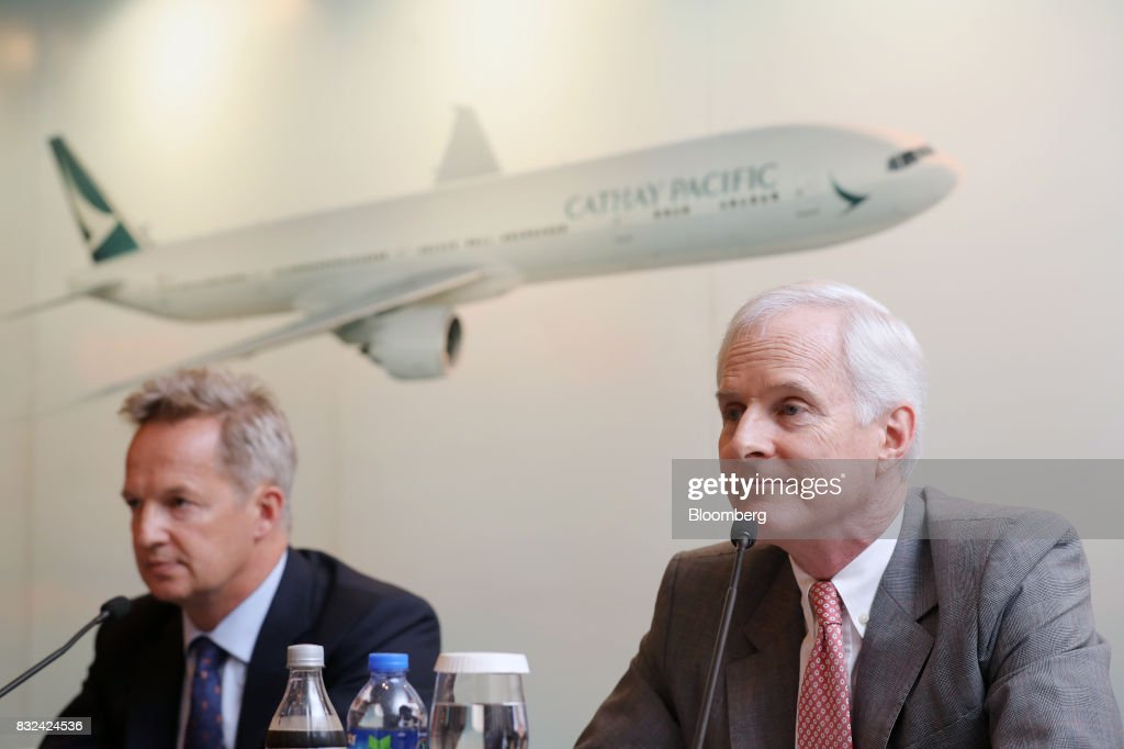 John Slosar, chairman of Cathay Pacific Airways Ltd., right, and Rupert Hogg, chief executive officer, listen during a news conference in Hong Kong, China, on Wednesday, Aug. 16, 2017. Cathay Pacific is slipping in its efforts to get passengers to pay more for its premium services in a test for new Chief Executive OfficerHoggas the company reported back-to-back losses. Photographer: Paul Yeung/Bloomberg via Getty Images