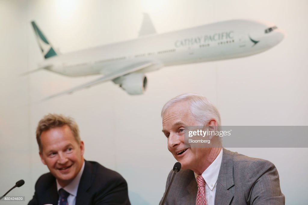 John Slosar, chairman of Cathay Pacific Airways Ltd., right, speaks as Rupert Hogg, chief executive officer, looks on during a news conference in Hong Kong, China, on Wednesday, Aug. 16, 2017. Cathay Pacific is slipping in its efforts to get passengers to pay more for its premium services in a test for new Chief Executive Officer Hogg as the company reported back-to-back losses. Photographer: Paul Yeung/Bloomberg via Getty Images