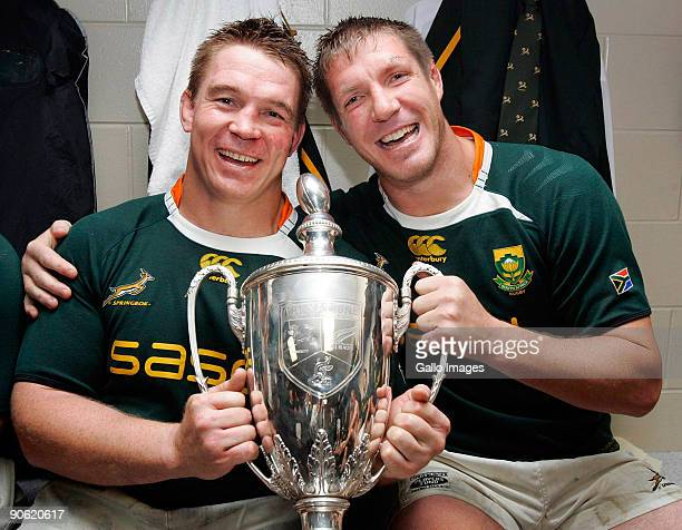 ZEALAND SEPTEMBER 12 John Smit and Bakkies Botha of South Africa pose in the dresssing room with the trophy after winning the Tri Nations Test...