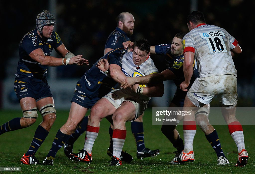 John Smit of Saracens is tackled by the Worcester defence during the Aviva Premiership match between Worcester Warriors and Saracens at Sixways Stadium on November 23, 2012 in Worcester, England.