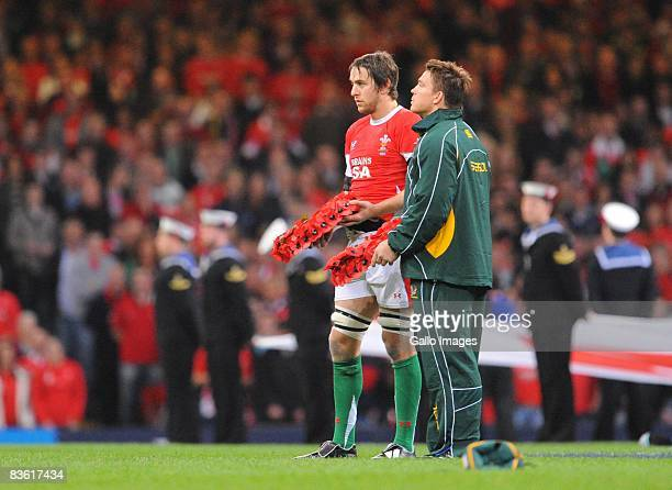 John Smit of South Africa and Rayn Jones of Wales hold Remembrance Day poppy wreaths before the International match between Wales and South Africa...
