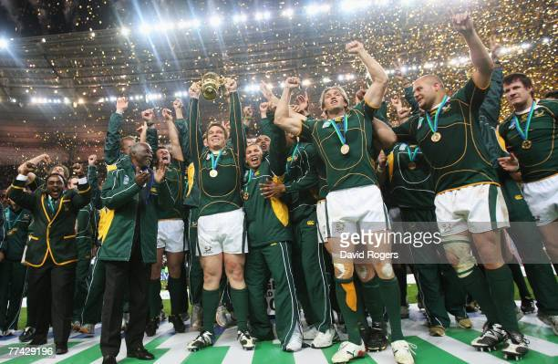 John Smit of South Africa lifts the trophy as his team mates celebrate following their team's victory at the end of the 2007 Rugby World Cup Final...