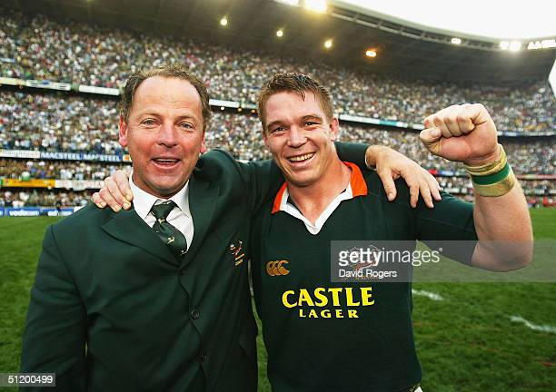 John Smit , the Springbok captain, and coach Jake White celebrate after winning the Tri-Nations Rugby Union International between South Africa and...