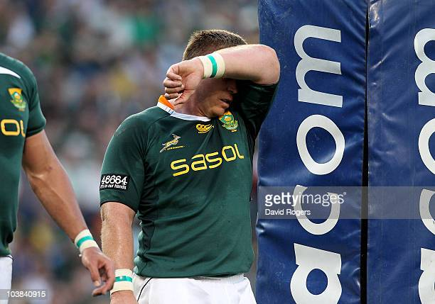 John Smit the Springbok captain looks dejected after his teams first half display during the 2010 TriNations match between the South African...