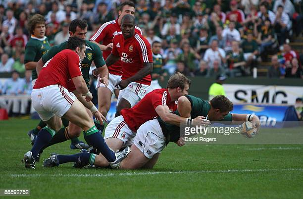 John Smit the Springboks captain dives over to score the first try during the First Test match between the South African Springboks and the British...