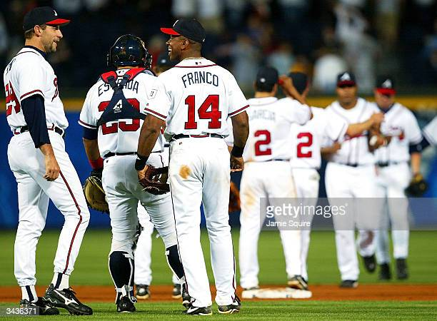 John Smoltz and Julio Franco of the Atlanta Braves smile after the Braves defeated the Florida Marlins 54 on April 16 2004 at Turner Field in Atlanta...