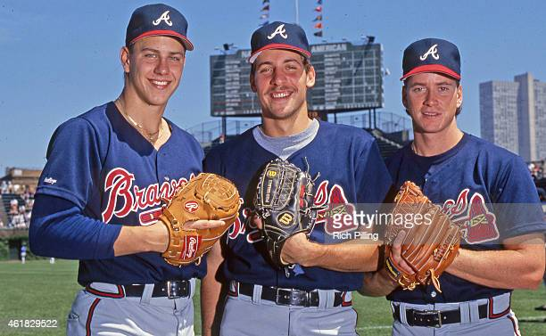 John Smoltz center of the Atlanta Braves is pictured with Steve Avery left and Tom Glavine right prior to a MLB game at Wrigley Field in Chicago...