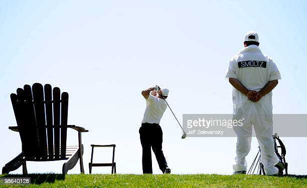 John Smoltz hits balls on the driving range during a taping of Trump's Fabulous World of Golf at the Trump National Golf Club on April 23 2010 in...