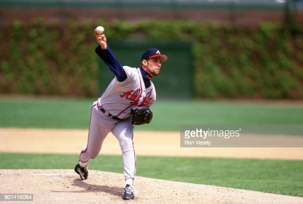 John Smoltz of the Atlanta Braves bats during an MLB game against the Chicago Cubs at Wrigley Field in Chicago Illinois during the 1993 season