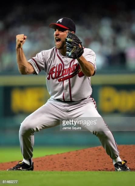 John Smoltz of the Atlanta Braves celebrates after a gameending double play against the Houston Astros as the Braves defeat the Astros 65 to force a...