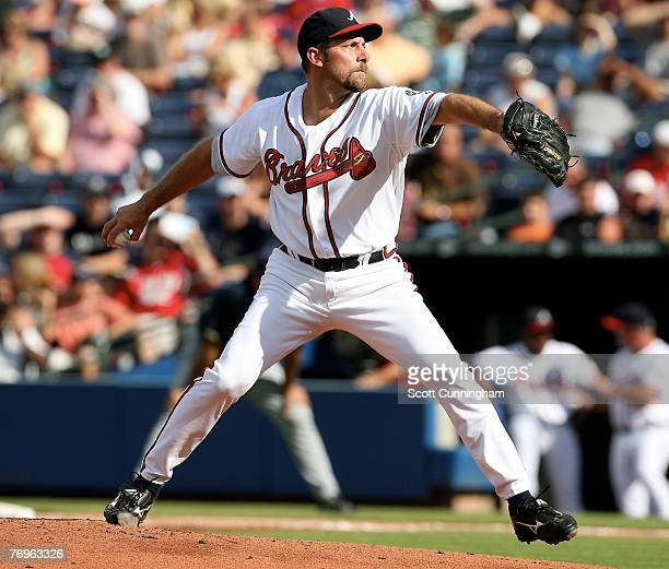 John Smoltz of the Atlanta Braves pitches against the Milwaukee Brewers at Turner Field on September 22 2007 in Atlanta Georgia The Braves defeated...