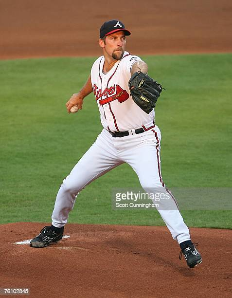 John Smoltz of the Atlanta Braves pitches against the San Francisco Giants at Turner Field on August 14 2007 in Atlanta Georgia The Braves defeated...