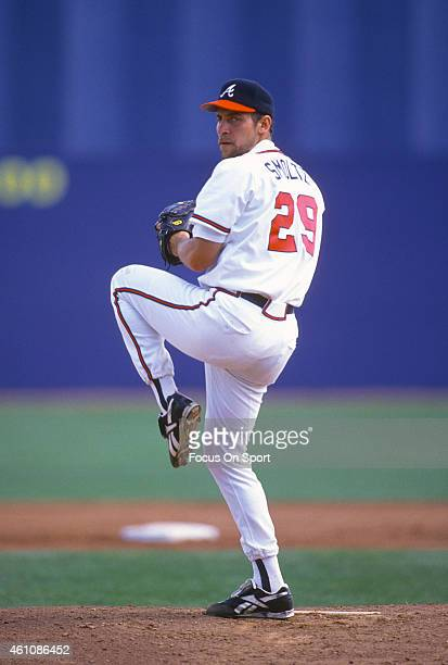 John Smoltz of the Atlanta Braves pitches during an Major League Baseball spring training game circa 1996 at West Palm Beach Municipal Stadium in...