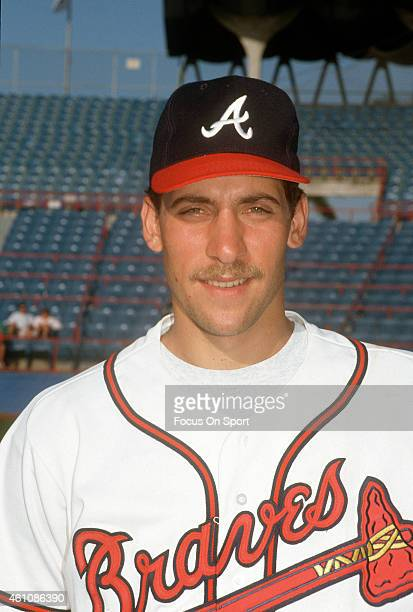 John Smoltz of the Atlanta Braves poses for this portrait during Major League Baseball spring training game circa 1992 at West Palm Beach Municipal...