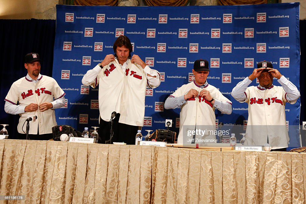 John Smoltz, Randy Johnson, Craig Biggio and Pedro Martinez don their Baseball Hall of Fame jerseys at the news conference for the 2015 Baseball Hall of Fame inductees January 7, 2015 in New York.