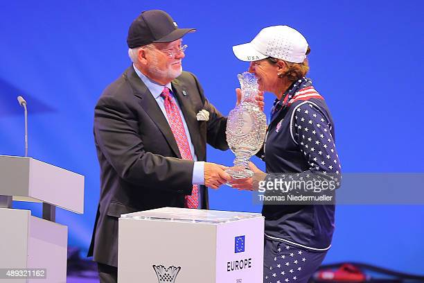John Solheim gives the trophy to Juli Inkster captain if the United States Team during the closing ceremony at the 2015 Solheim Cup at St LeonRot...