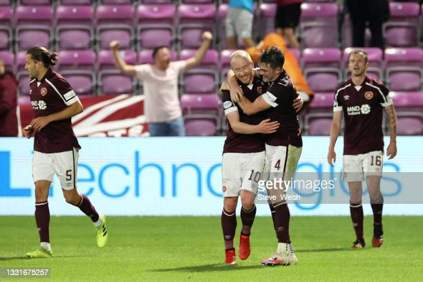 John Souttar of Heart of Midlothian celebrates with teammate Liam Boyce after scoring his team's second goal during the Ladbrokes Scottish...