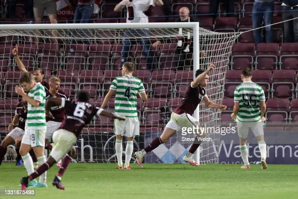 John Souttar of Heart of Midlothian celebrates with teammates after scoring his team's second goal during the Ladbrokes Scottish Premiership match...
