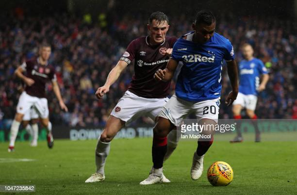 John Souttar of Heart of Midlothian vies with Alfredo Morelos of Rangers during the Scottish Ladbrokes Premiership match between Rangers and Hearts...