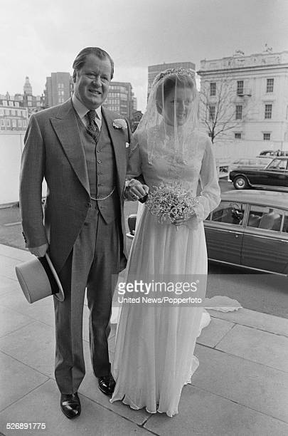 John Spencer 8th Earl Spencer arrives with his daughter Lady Jane Spencer before her wedding to Robert Fellowes in London on 20th April 1978