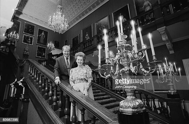 John Spencer 8th Earl Spencer with his second wife Raine Countess Spencer at Althorp the family seat in Northamptonshire December 1986
