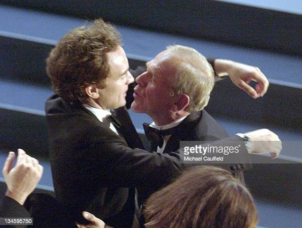 John Spencer winner for Best Supporting Actor in a Drama Series 'The West Wing' receives a buss from costar Bradley Whitford at the 54th Annual Emmy...