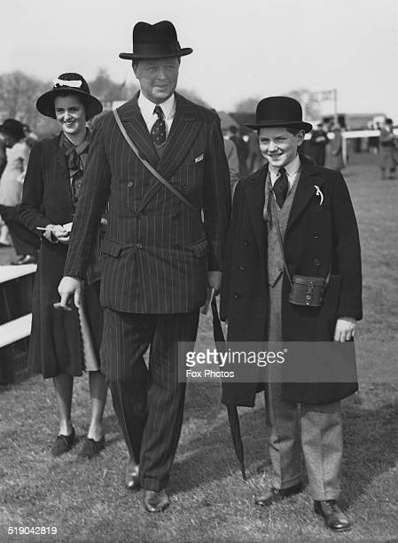 John Spencer-Churchill, 10th Duke of Marlborough , at the first day of a spring race meeting at Epsom, Surrey, 18th April 1939. With him are two of...