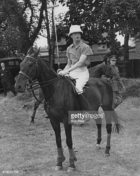 John SpencerChurchill Marquess of Blandford ready to play for the Cowdray Park team against Beechwood at a polo tournament at Roehampton London 13th...