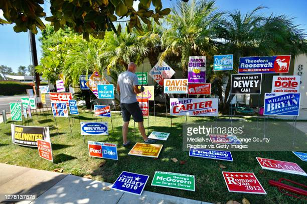 John Spiak, director of the Grand Central Art Center, assembles a political art installation on a front lawn in Orange, California on October 2,...