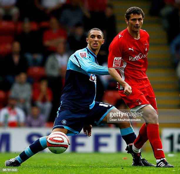 John Spicer of Leyton and Lewis Montrose of Wycombe battle for the ball during the CocaCola League One match between Leyton Orient and Wycombe...