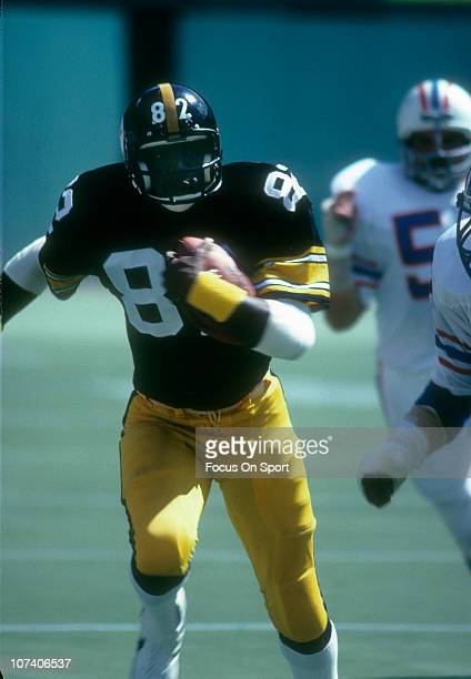 John Stallworth of the Pittsburgh Steelers runs with the ball against the Houston Oilers during an NFL football game at Three Rivers Stadium circa...