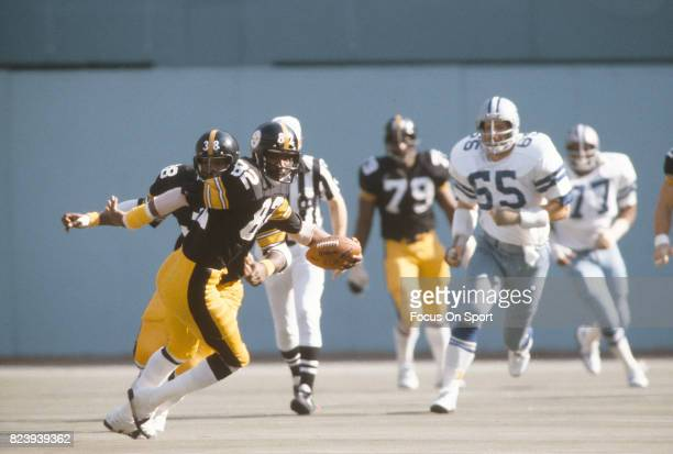 John Stallworth of the Pittsburgh Steelers runs with the ball against the Dallas Cowboys during an NFL football game October 28 1979 at Three Rivers...