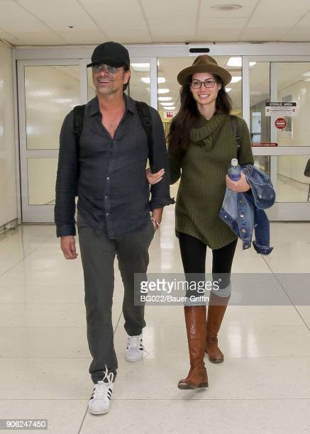 John Stamos and Caitlin McHugh are seen on January 17 2018 in Los Angeles California