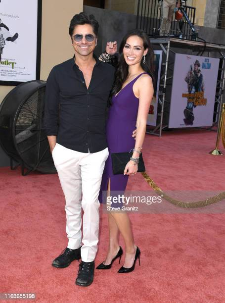 John Stamos and Caitlin McHugh arrives at the Sony Pictures' Once Upon A TimeIn Hollywood Los Angeles Premiere on July 22 2019 in Hollywood California