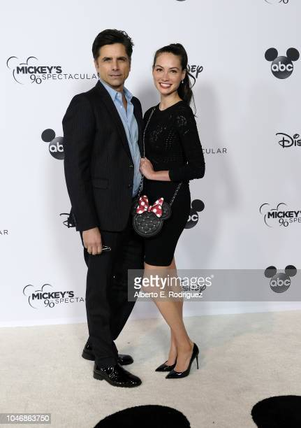 John Stamos and Caitlin McHugh attend Mickey's 90th Spectacular at The Shrine Auditorium on October 6 2018 in Los Angeles California