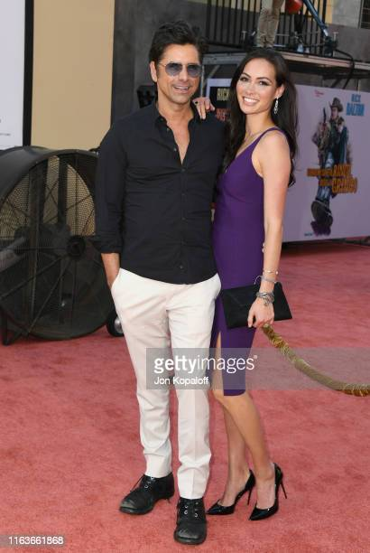 John Stamos and Caitlin McHugh attend Sony Pictures' Once Upon A TimeIn Hollywood Los Angeles Premiere on July 22 2019 in Hollywood California