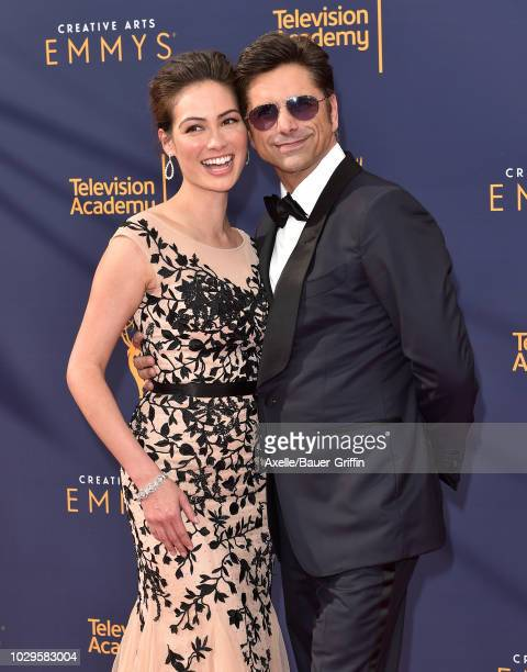 John Stamos and Caitlin McHugh attend the 2018 Creative Arts Emmy Awards at Microsoft Theater on September 8 2018 in Los Angeles California
