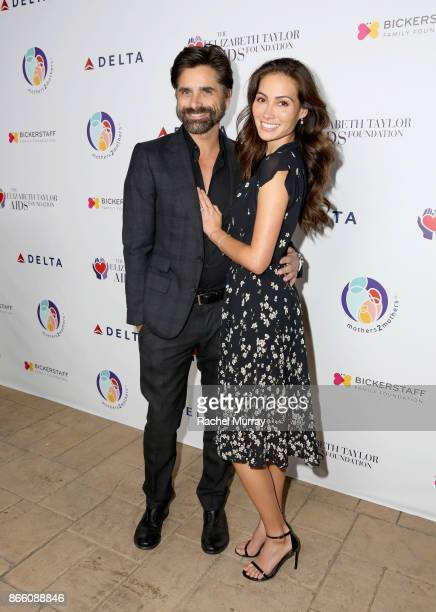 John Stamos and Caitlin McHugh attend The Elizabeth Taylor AIDS Foundation and mothers2mothers dinner at Ron Burkle's Green Acres Estate on October...